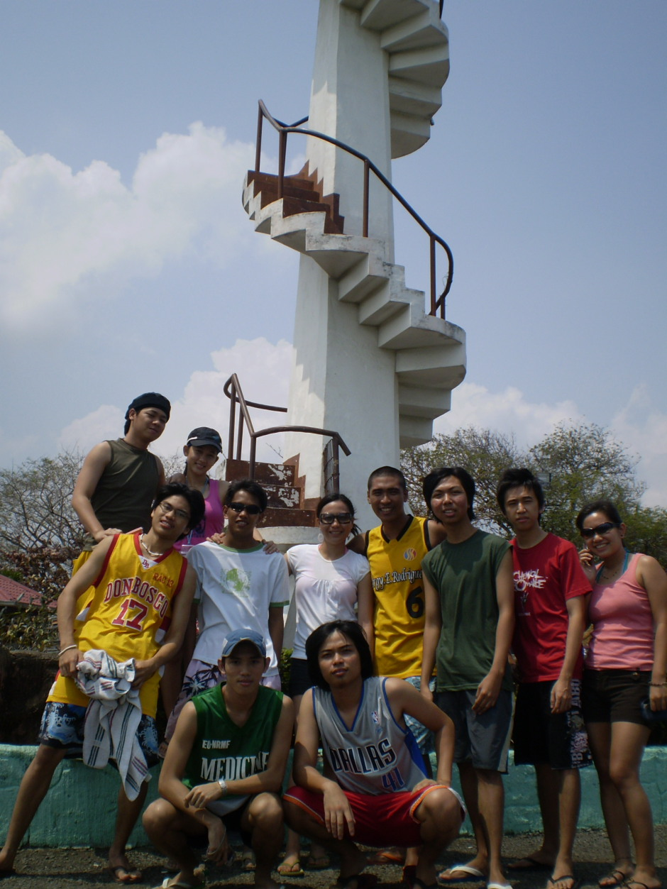 Us beside a lighthouse with spiral stairs