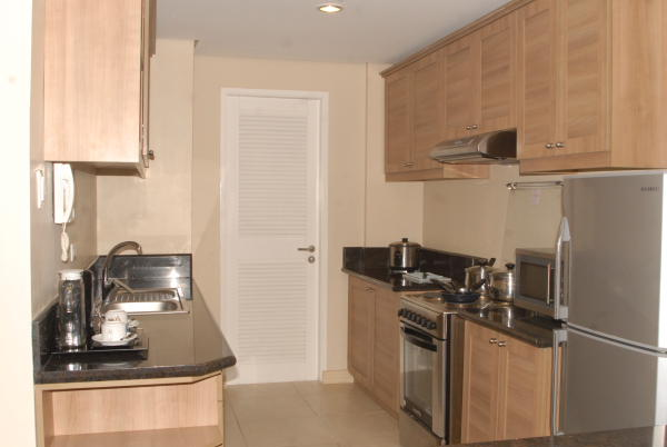 A fully-equipped kitchen inside a room of Crosswinds Resort Suites