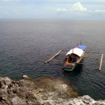 Boat docked at Manlanat Islands in Jomalig
