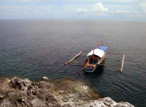 Boat docked at Manlanat Islands in Jomalig