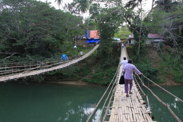 My mom and twin brother crossing the Sipatan Hanging Bridge