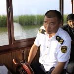 Binjiang-Wetland-Boat-Man
