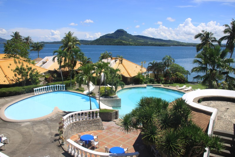 Leyte Park Hotel showing its pools and villas with Mount Danglay at the background