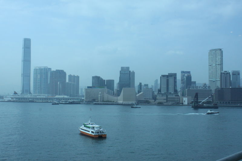 Daytime view of Victoria Harbour from Wan Chai Pier during my first travel abroad